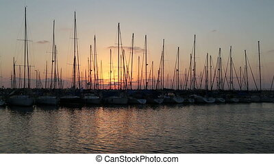 Boats dock in the marine at sunset