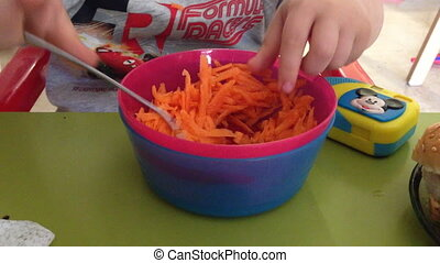 boy eat sliced carrots - Shot of boy eat sliced carrots
