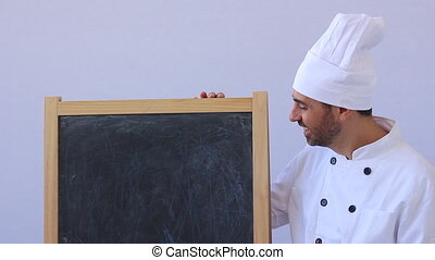 Shot of chef with blackboard