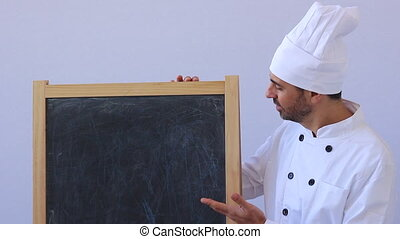 Shot of chef with board advertise