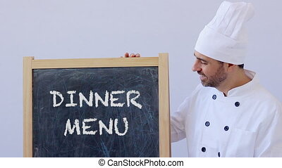 Chef with DINNER MENU sign