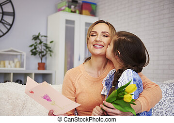 Shot of child kissing her mommy on the cheek