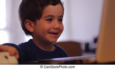 child using computer - Shot of child using computer