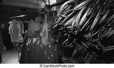 A medium shot of clothes and wires in black and white