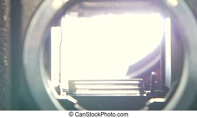 Shot of diaphragm camera shutter blade in slow motion,...