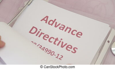 Shot of Doctor holding advance directives papers
