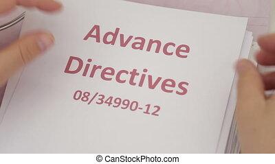 Shot of Doctor holding advance directives documentation -...
