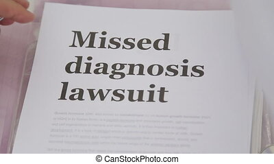 Shot of Doctor Holding Missed Diagnosis lawsuit papers -...