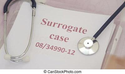 Shot of Doctors reading surrogate decision maker papers -...