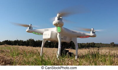 Drone with camera attached takeoff - Shot of Drone with...