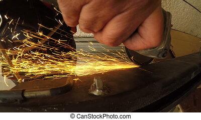 Extreme close up on grinder creating sparks in k - Shot of...