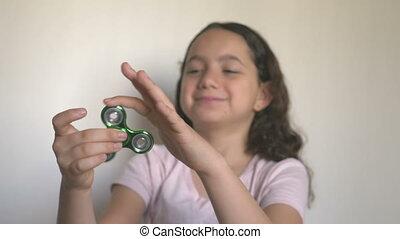 Girl with fidget spinner - Shot of Girl with fidget spinner