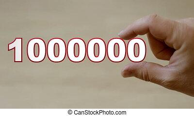 Hand holding MILLION - Shot of Hand holding MILLION