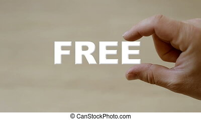 Hand holding the word free