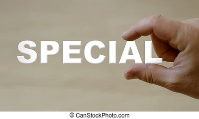 Hand holding the word special