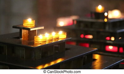 Handheld shot of candles in a church - Shot of Handheld shot...