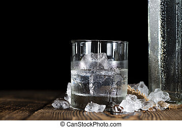Vodka - Shot of ice cold Vodka on rustic wooden background