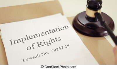 Implementation of Rights lawsuit verdict with gavel placed...