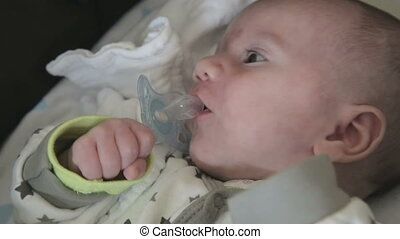 Little newborn baby struggle for his pacifier - Shot of...