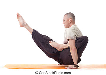 Shot of muscular man posing in difficult asana
