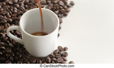 "Shot of Pouring coffee into cup with copy space - ""100%,..."