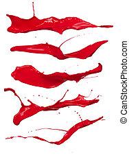 Shot of red paint splashes, isolated on white background