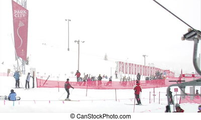 Shot of skiiers at base of hill on a snowy day