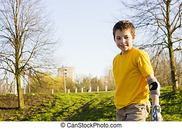 Shot of smiling sliding rollerskaters in protection kit