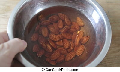 Soaked almonds in water - Shot of Soaked almonds in water