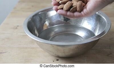 Soaking almonds in water