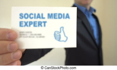 Social Media Expert present Business Card - Shot of Social...