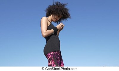 Shot of Sportive woman with an afro hairstyle stand and think