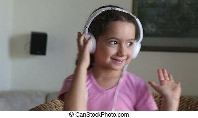 Sweet little girl with headphones