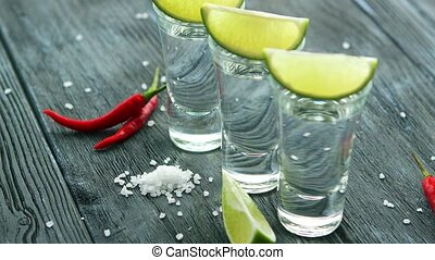 Shot of tequila with salt and lime - Served glass shots...