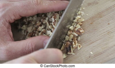 Top view of chopping walnuts