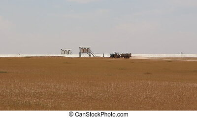 Tractor plowing agricultural growth areas - Shot of Tractor...