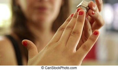 Trying on a ring on finger