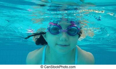 Underwater shot of girl swimming - Shot of Underwater shot...