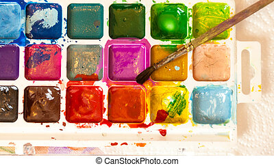 Shot of watercolor palette with brush