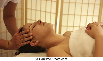 Woman having face massage in a spa