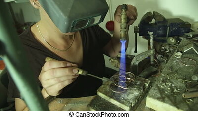 Woman melting and putting a filler metal - Shot of Woman...