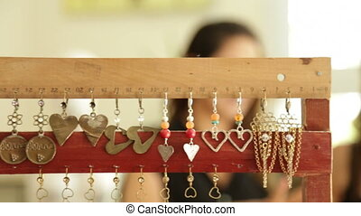 Woman pick hand made designer jewelry - Shot of Woman pick...