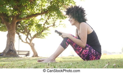 Woman smiling as she read text on mobile phone