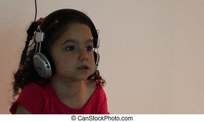 Young girl with big earphones