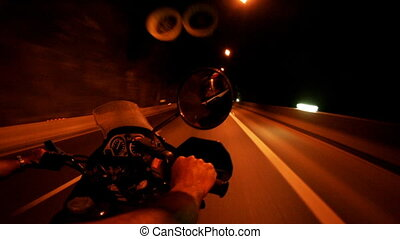 shot off the back of a motorbike racing through tunnels