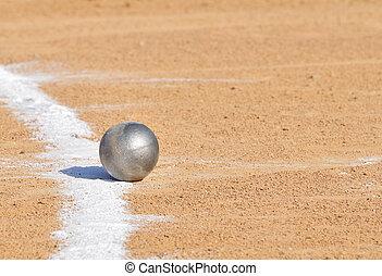 Shot Put by Chalk Line on Dirt