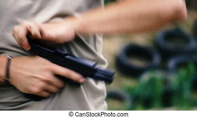 Shot. Slow motion shot of a pistol