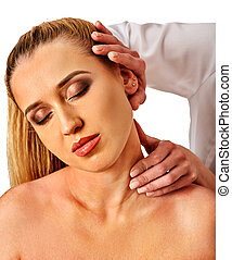 Shoulder and neck massage for woman in spa salon.