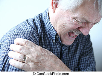shoulder joint pain in older man - senior man suffering from...