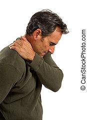 Shoulder Pain Man - Middle aged man rubs his shoulder to...